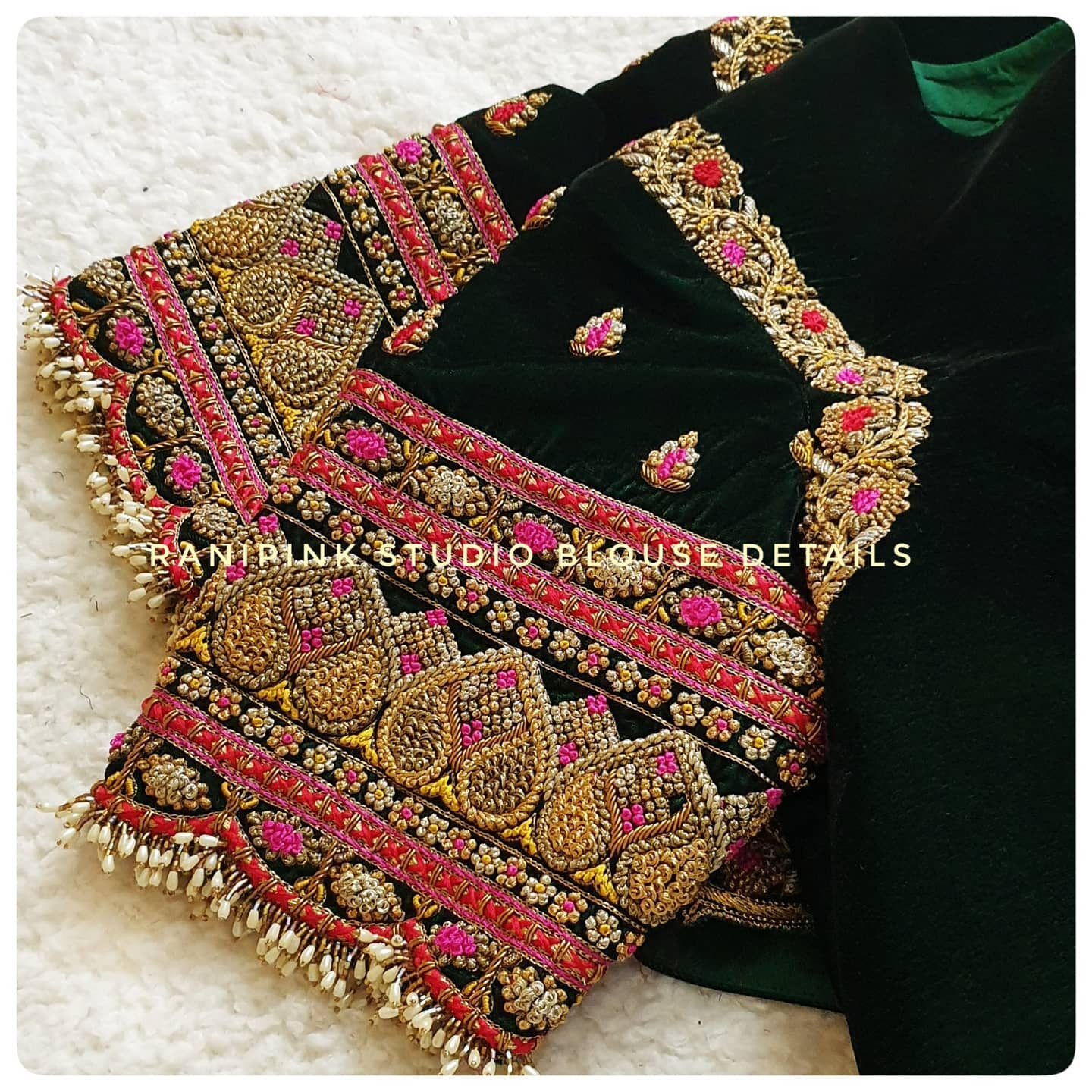 Details of a Velvet blouse by Rani pink studio. Gorgeous bottle green color velvet cloth with floral and creeper design hand embroidery bead and stone 3D maggam work.  2021-04-13