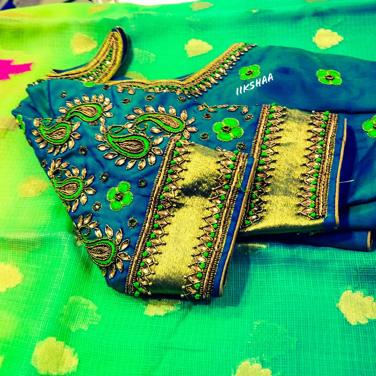 Gorgeous bridal blouse with floral and mango design hand embroidery bead and kundan aari work.  2021-04-13