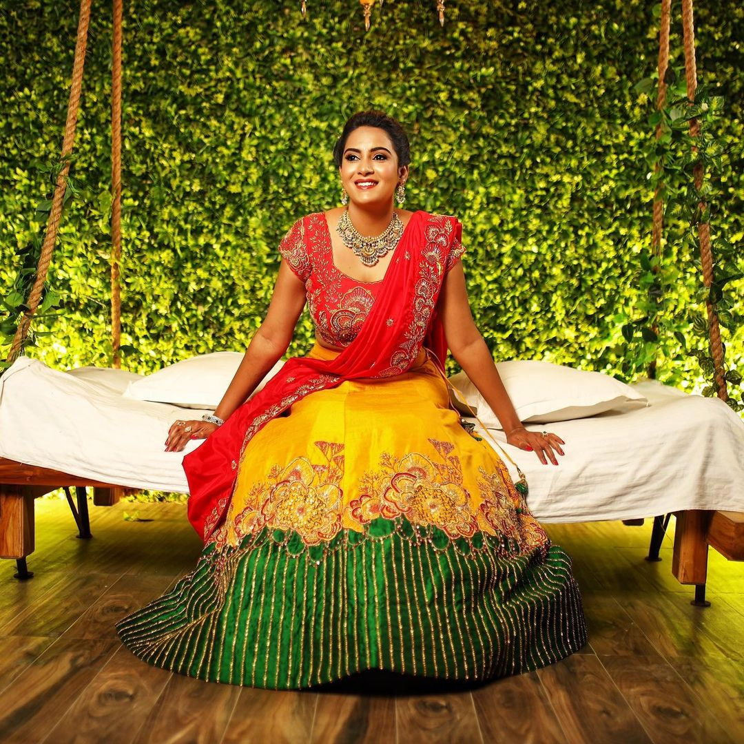 Beautiful actress Himaja in yellow green and red combination halfsaree.  Outfit By Bhargavi Amirineni. 2021-04-13