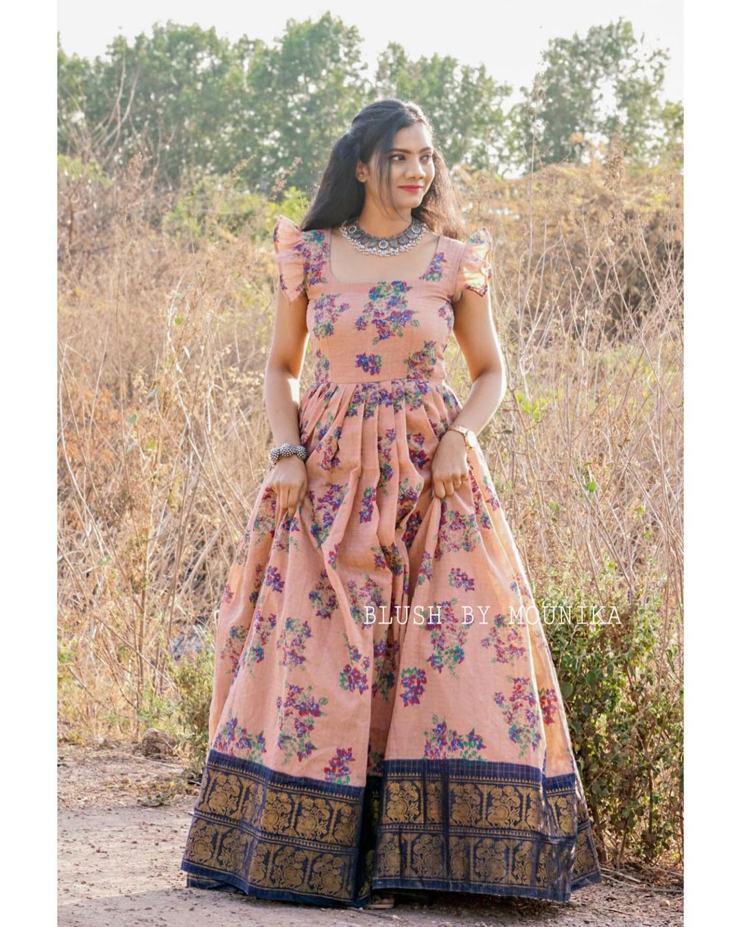 Champa . Price : ₹4200/- Handloom Cotton Maxi Dress with Floral Print Zari checks and Zari border. Sleeves can be customized. 2021-04-14
