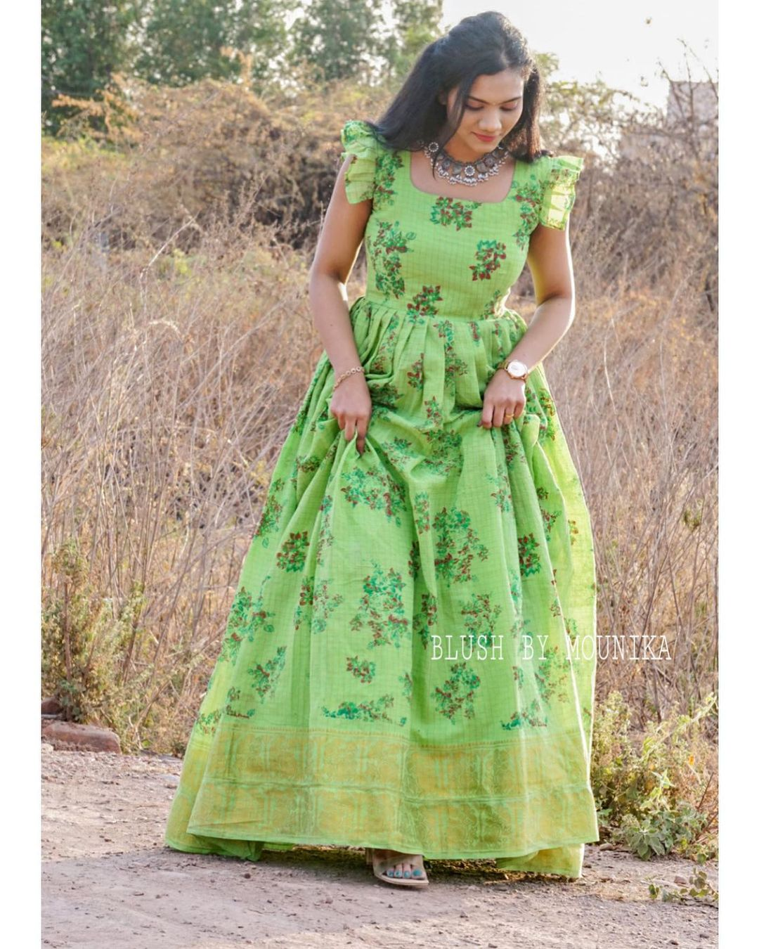 Chiluka. Price : ₹4200/- Handloom Cotton Maxi Dress with Floral Print Zari checks and Zari border. Sleeves can be customized. 2021-04-14