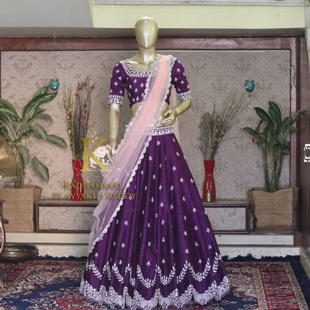 Stunning purple color lehenga and blouse with blush pink net dupatta. Purple lehenga with silver thread hand embroidery work. This outfit is Available at Rs 48000/- from house of Kadhambari. They can customize size as per your requirement. They have international shipping service too. For Orders and Enquiry Reach  on WhatsApp +91 8801876477 // +91 9063479099 2021-04-14