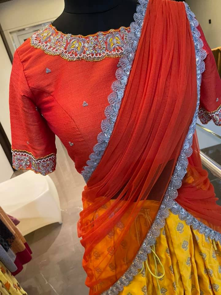 Stunning yellow color lehenga and orange color high neck blouse with net dupatta. Blouse with hand embroidery work on neckline. Ready to ship Price : 11500 INR To order WhatsApp 7013728388.  2021-04-15