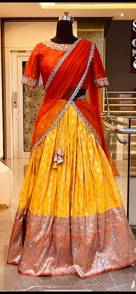 Stunning yellow color lehenga and orange color high neck blouse with net dupatta. Blouse with hand embroidery work on neckline. Ready to ship