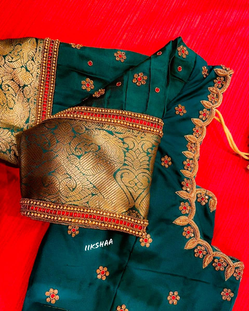 Gorgeous powder blue color designer blouse with floral buti design hand embroidery bead and gold thread aari work. Blouse with cut work on neckline.  2021-04-15