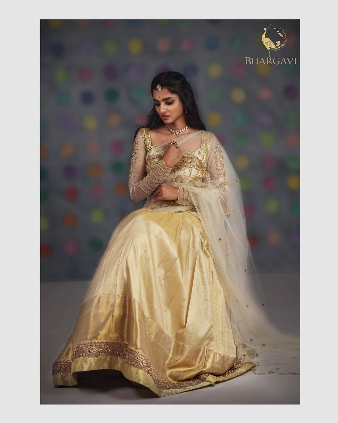 Beautiful gold shade silk lehenga and blouse with net dupatta. Blouse with see through net sleeves. Blouse with hand embroidery work.  2021-04-15