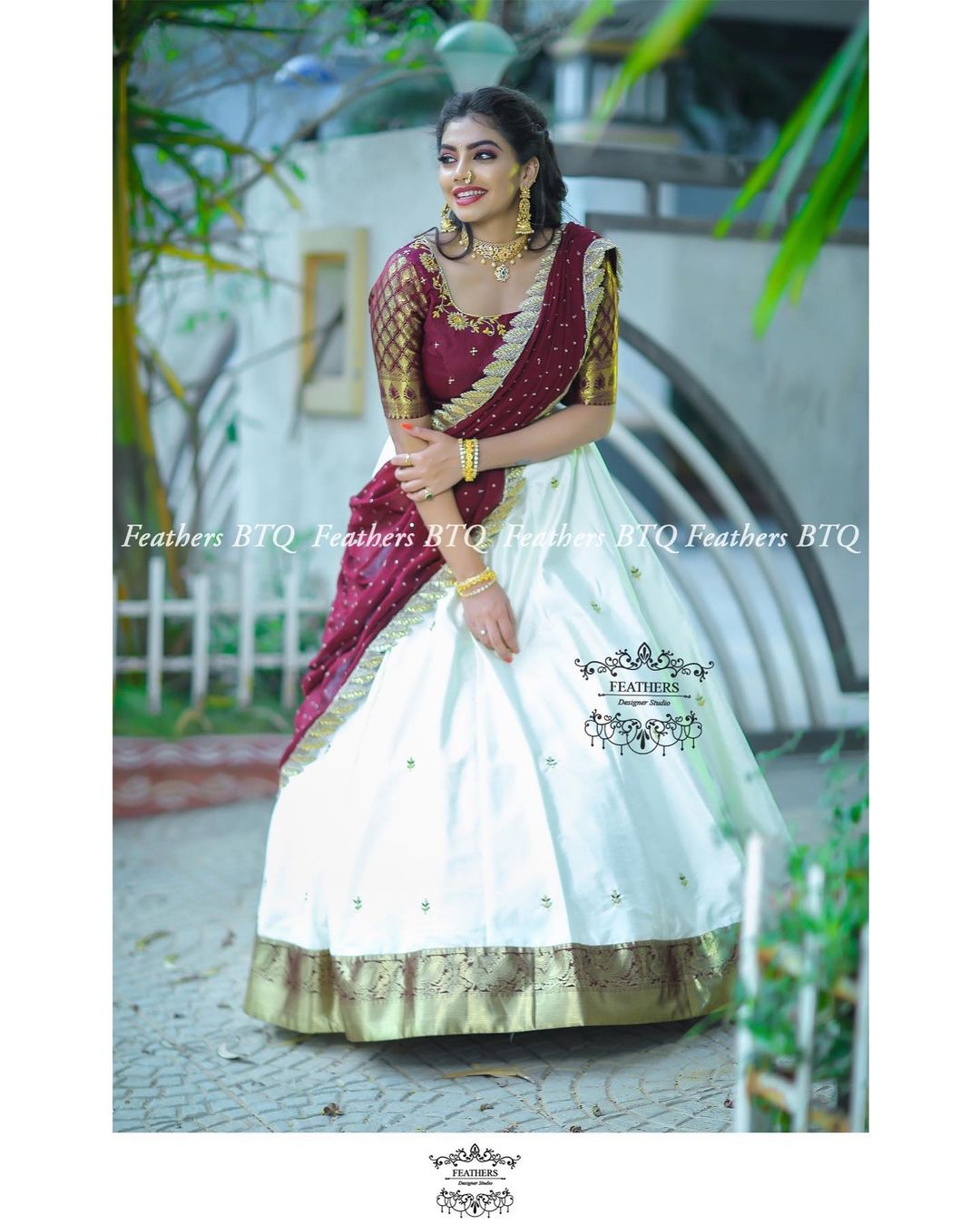 Stunning pearl white color pattu lehenga and wine color blouse with net dupatta. Blouse with gold zari sleeves. 2021-04-15