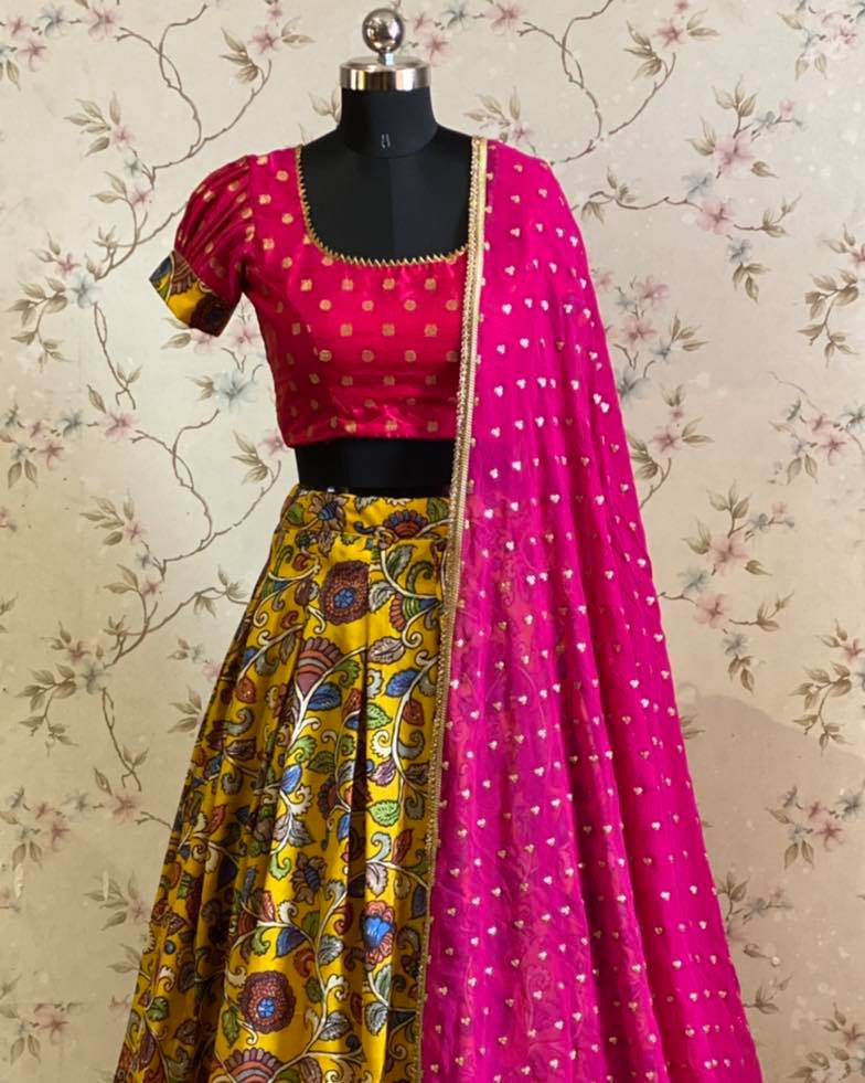 Stunning and evergreen yellow and pink combo Kalamkari pure silk lehanga paired with pure silk blouse and gorgette with sequnce buti dupatta.  2021-04-16