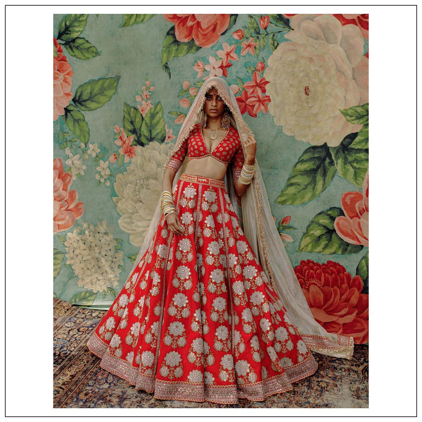 The Sabyasachi 2021 Collection. Stunning red bridal lehenga set.