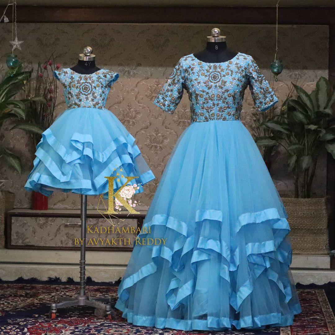 Gorgeous sky blue color mom and daughter outfit. Floor length multi layer dress with hand embroidery work on yoke.  2021-04-16