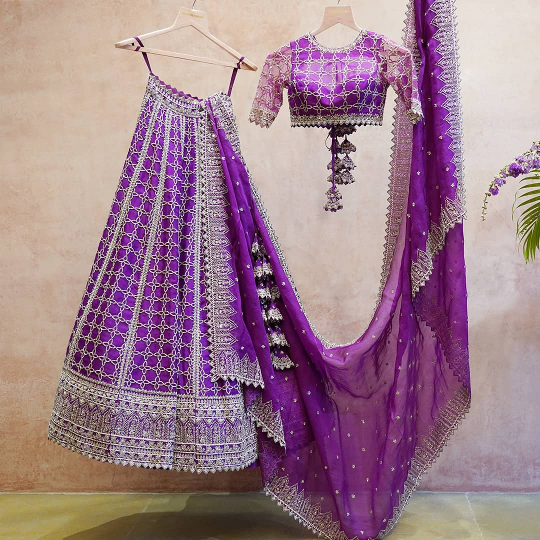 Gorgeous purple color bridal lehenga and blouse with net dupatta. Purple lehenga set with silver thread hand embroidery work.  2021-04-16