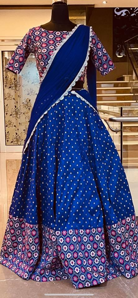 Beautiful blue color raw silk lehenga and blouse with net dupatta. Blouse with embroidery work. Ready to ship