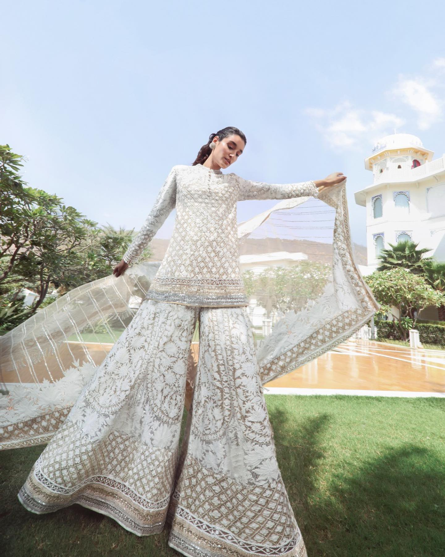 An ensemble that speaks all things gorgeous and glamour. Meticulous Kashmiri details the modern opulence of sequin textures scalloped ivory beaded rims on Manish Malhotra Sharara Kurti set memos all the elegant bolts of the #Nooraniyat realm! 2021-04-17