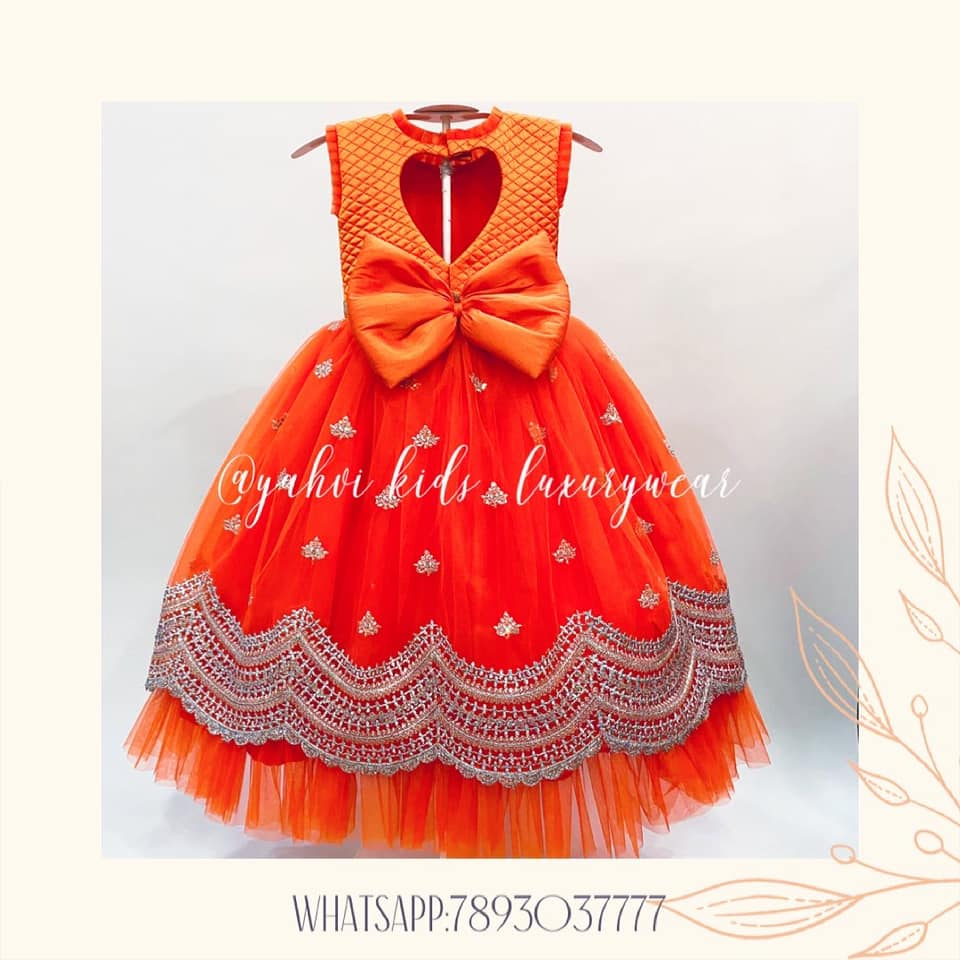 A Royal Wedding Designs for Kids. Stunning tomato red color kids gown.  2021-04-17
