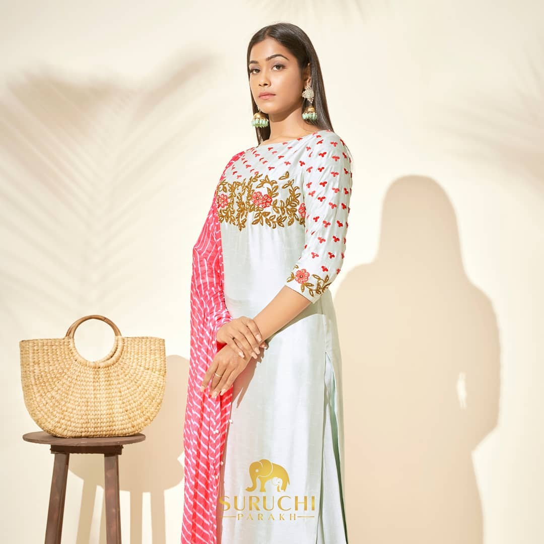 Thread worked kurta adorned with pearls and sequin paired with a pretty leheriya dupatta and a monochrome sharara! Looking for something to impress your in-laws in? Here it is! 2021-04-17