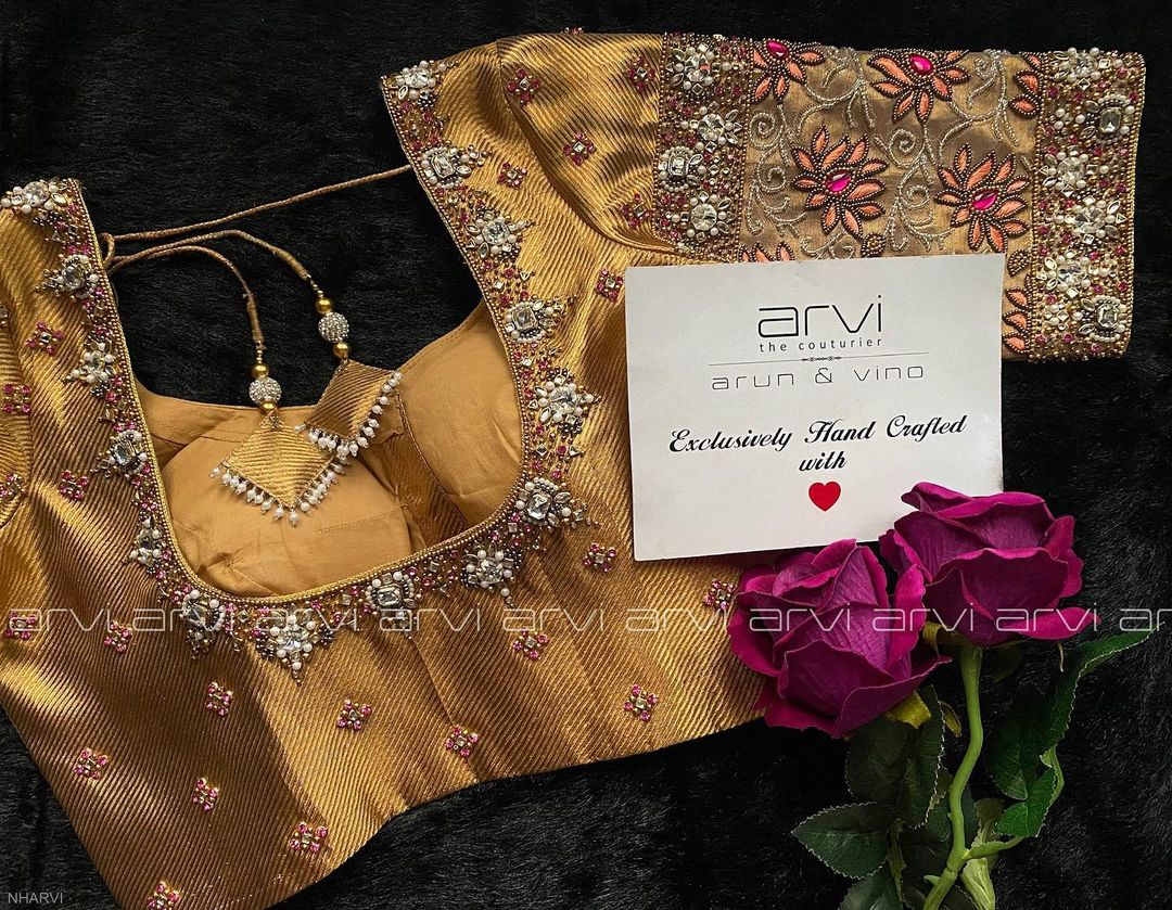 Gorgeous gold shade designer blouse with lotus flower and creeper design hand embroidery glass bead aari work.  2021-04-17