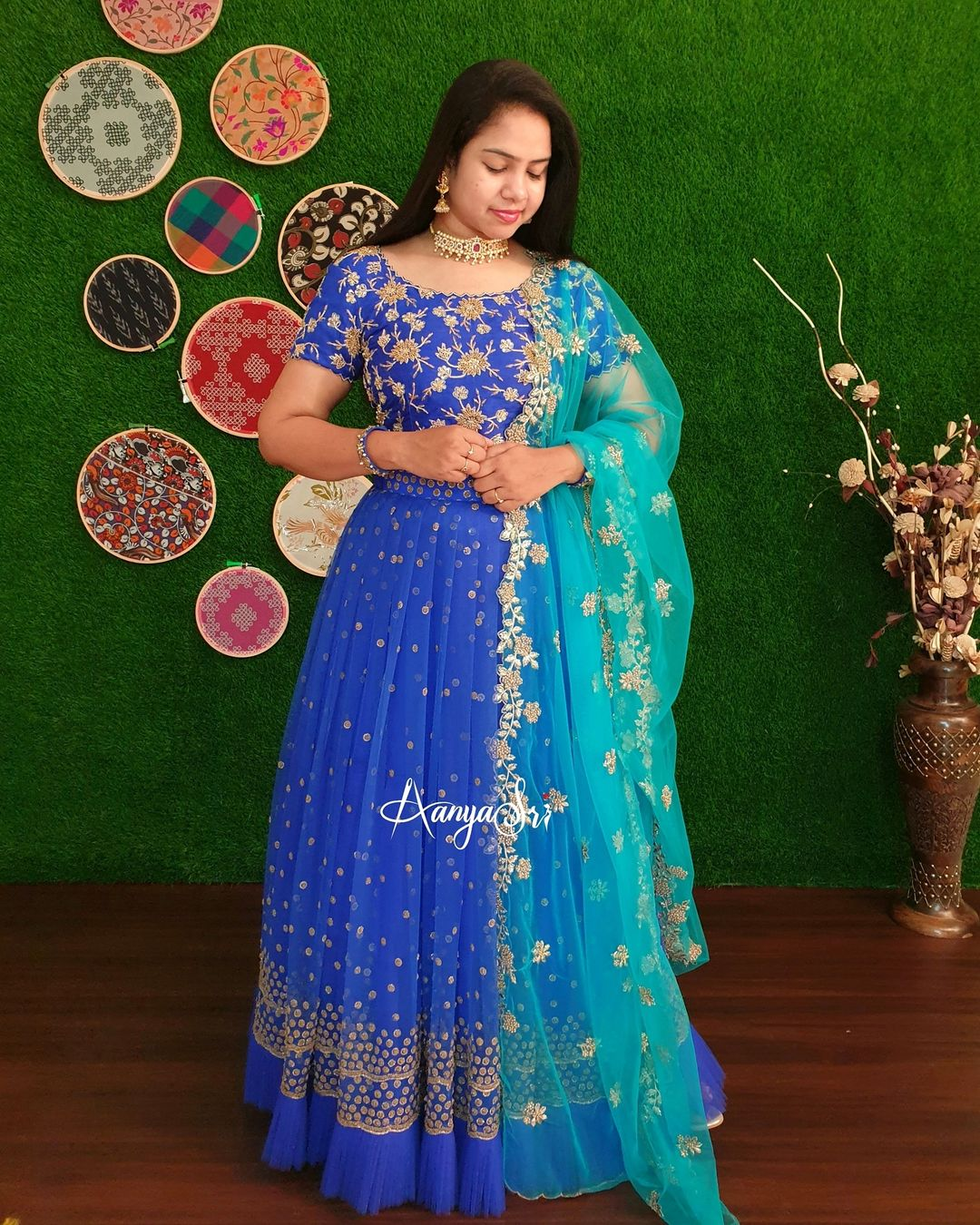 Royal blue antique heavy hand worked blouse with a beautiful net lehenga. Frills attached at the edge of lehenga and paired with a net cutwork dupatta. 2021-04-17