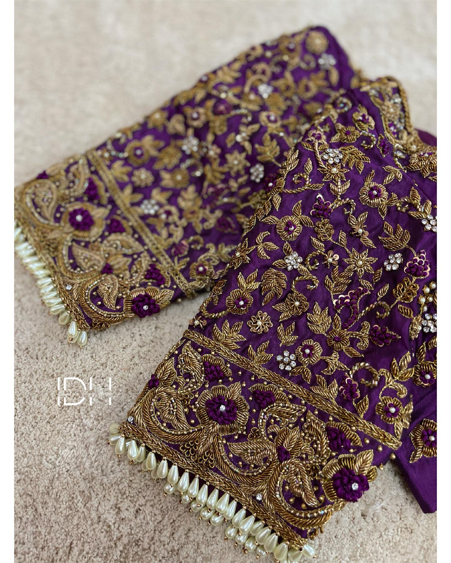 Stunning purple color bridal blouse with floral and creeper design hand embroidery zardosi work.  2021-04-18