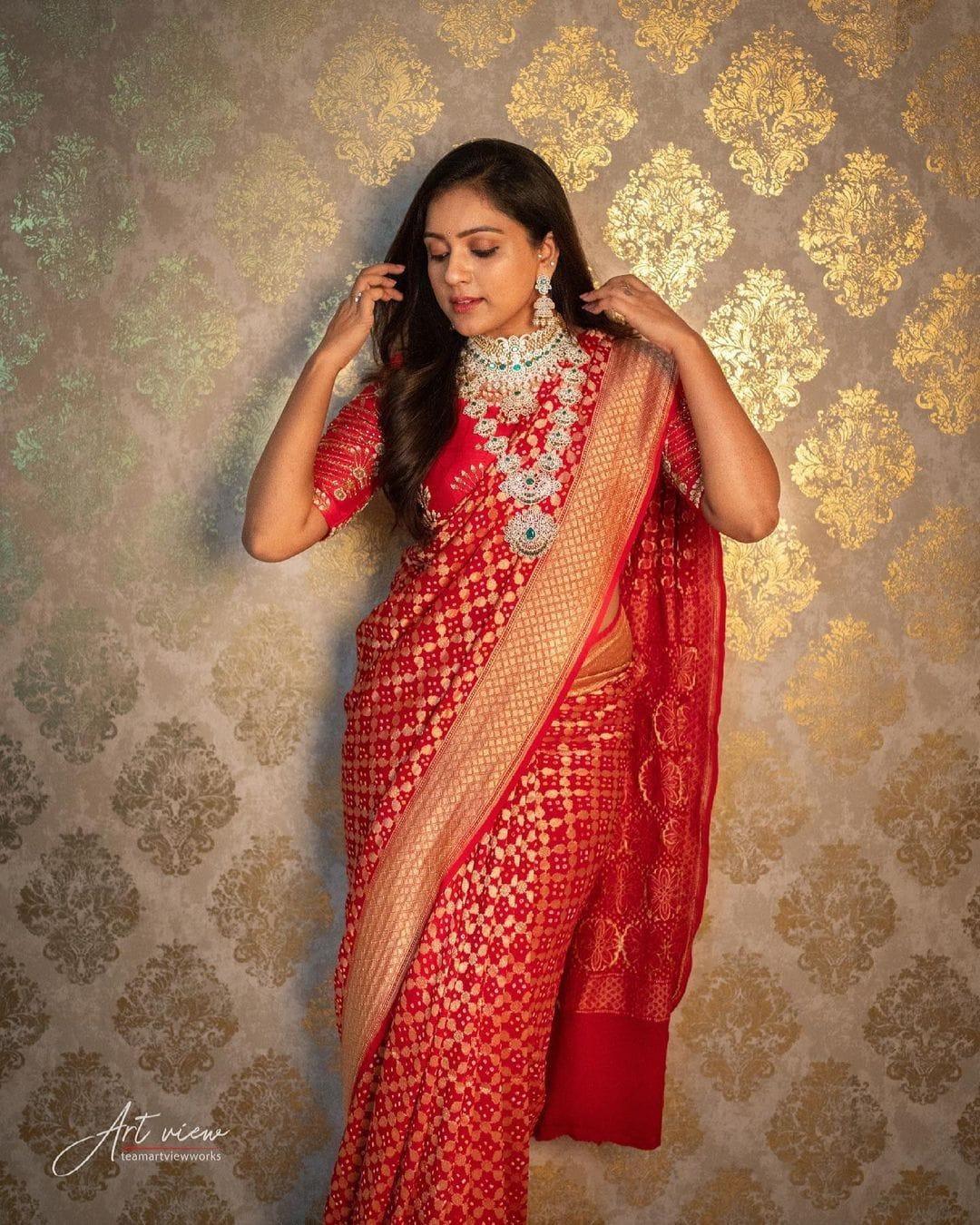 Beautiful Vithika Sheru in red benarsi saree. Saree : Sri Krishna Silks. Jewellery   : Manepally Jewellers. PC- Art view works. 2021-04-18