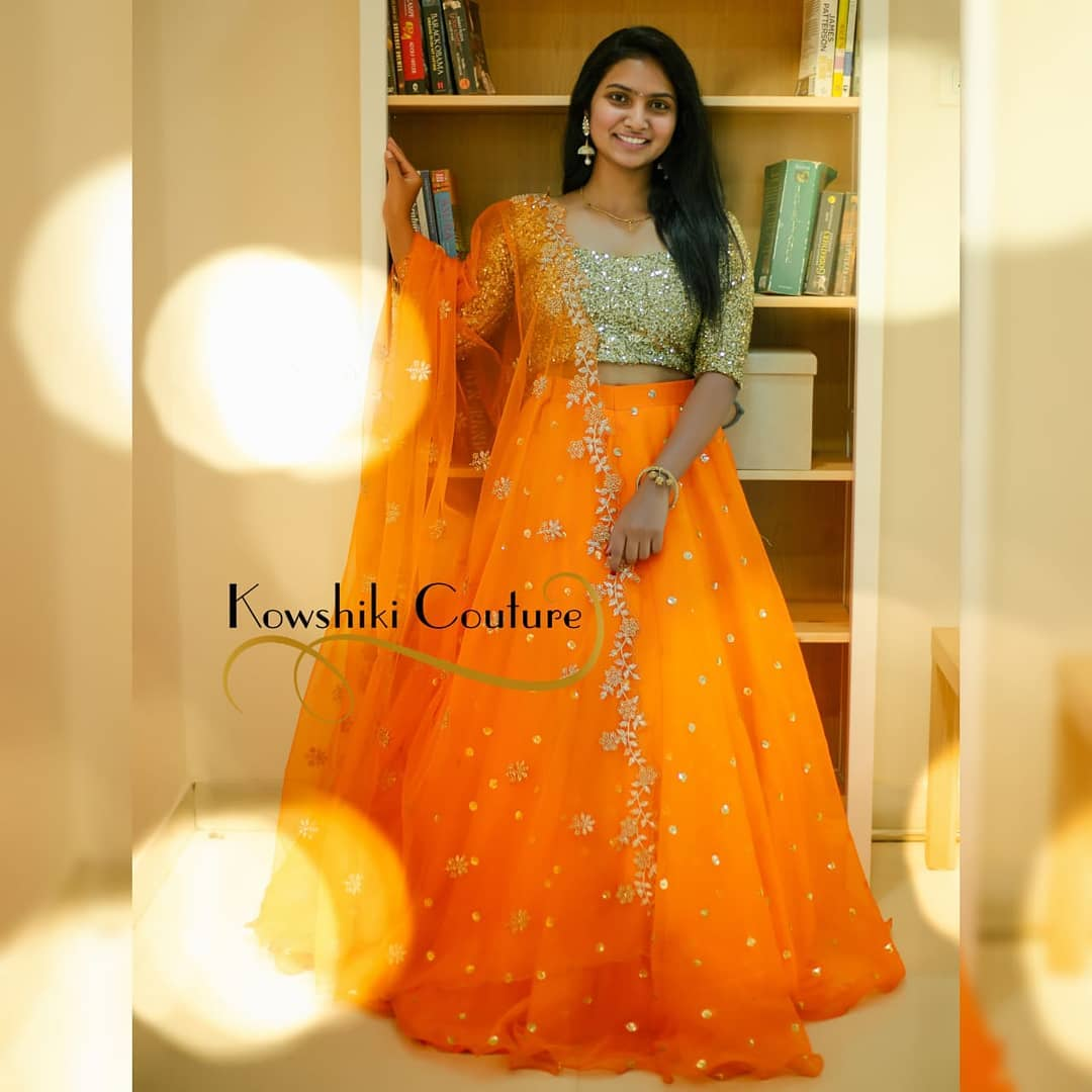 Stunning orange color lehenga and gold sequin blouse with net dupatta. Lehenga and dupatta with hand embroidery work.  2021-04-19