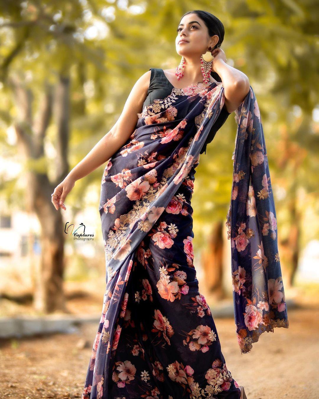 Beautiful actress Poorna or  Shamna Kasim in black floral saree.   2021-04-20