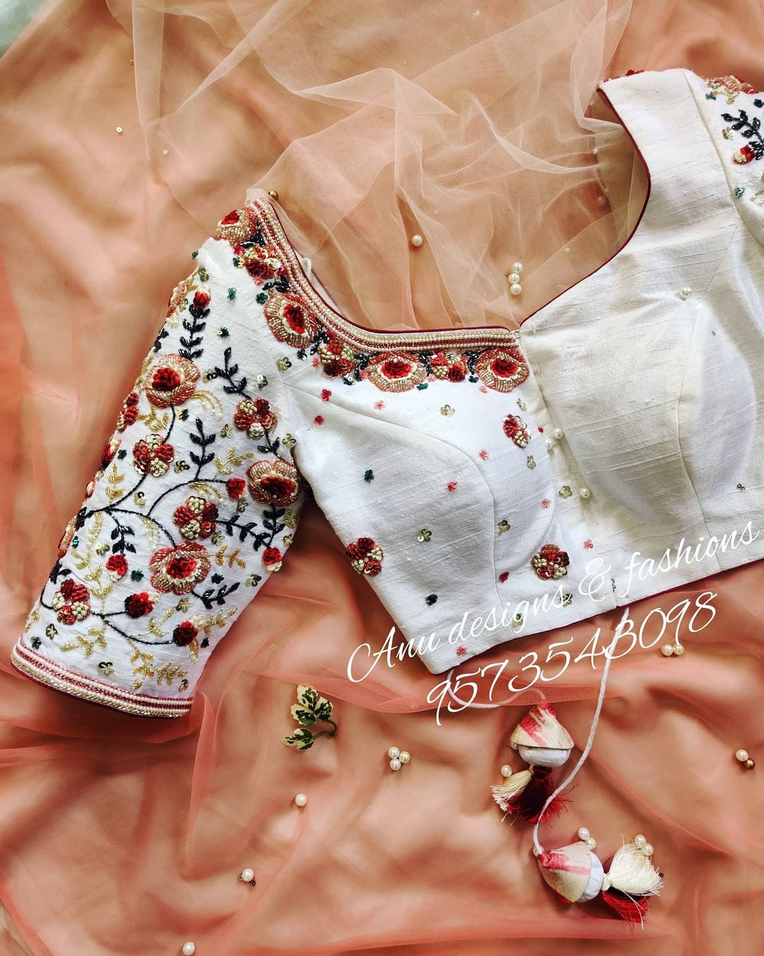Gorgeous pearl white color designer blouse with creeper and floral design hand embroidery 3D maggam work. Only blouse cost is Rs.12500/- includes embroidery and stitching. 2021-04-20