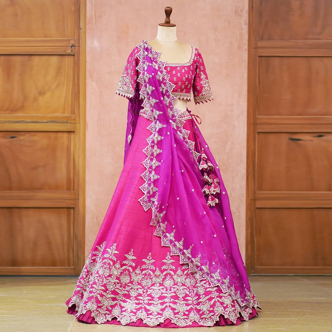 Gorgeous pink color bridal lehenga and blouse with purple net dupatta. Lehenga and blouse with royal silver thread embroidery work.  2021-04-21