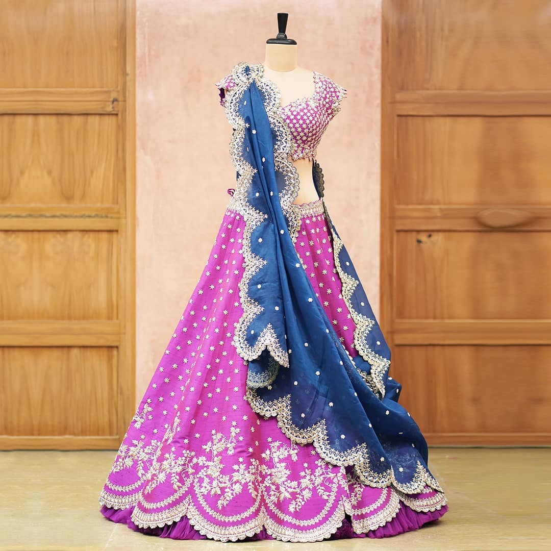 Gorgeous lavender color bridal lehenga and blouse with powder blue dupatta. Lehenga and blouse with royal silver thread and stone embroidery work.  2021-04-21