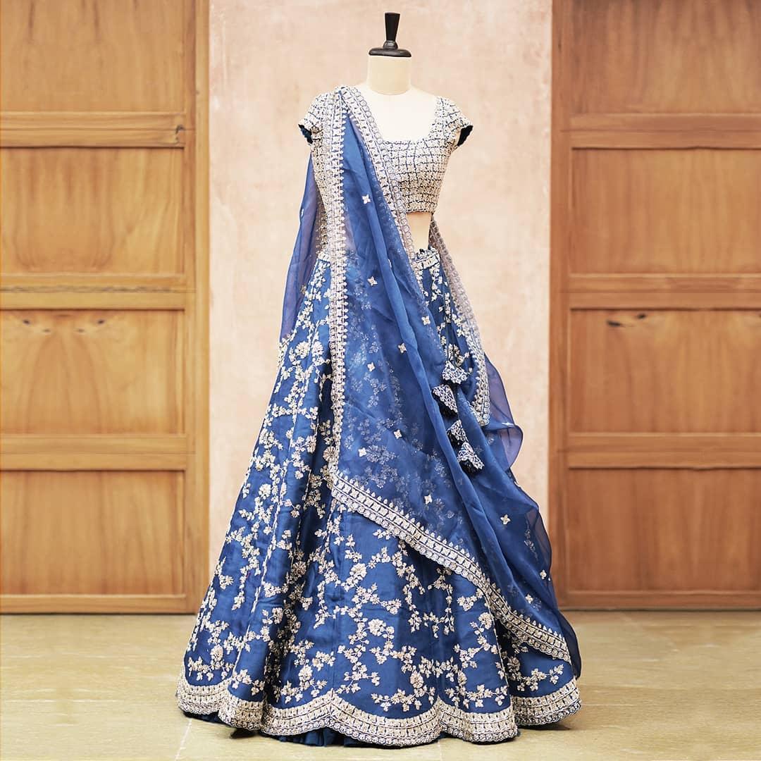 Stunning powder blue color designer lehenga and blouse with net dupatta. Lehenga and blouse with stone embroiderywork.  2021-04-21