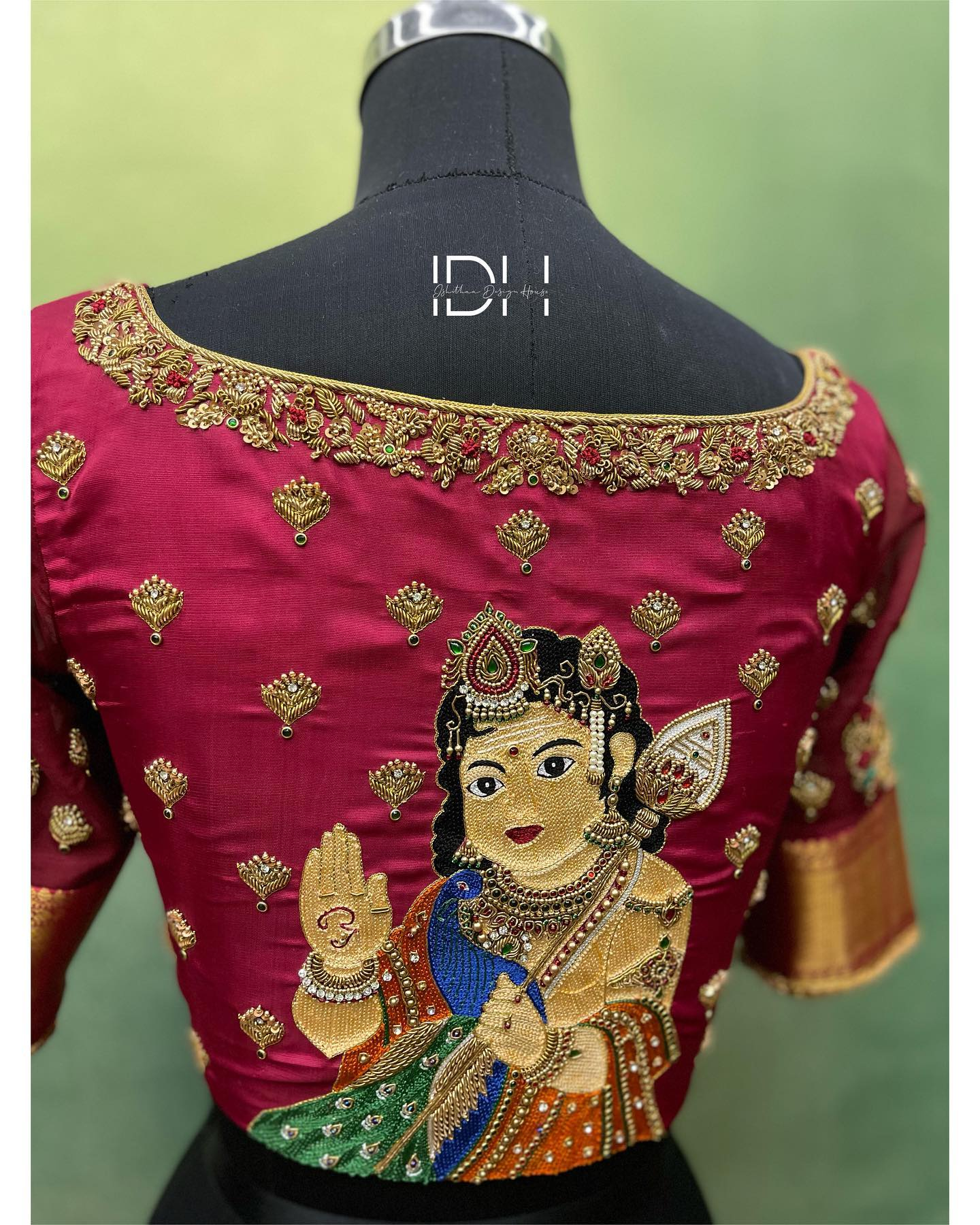 Gorgeous wine color designer blouse with Lord Kuamara swani design hand embroidery maggam work on back. Blouse with peacock zardosi work on sleeves.  2021-04-22