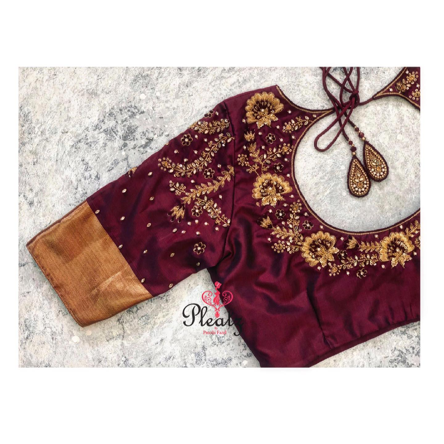 Maroon and gold always adds a rich and classy look to the brides! Love this bridal blouse . Stunning maroon color designer blouse with floral and climber design hand embroidery gold thread maggam work blouse.  2021-04-22