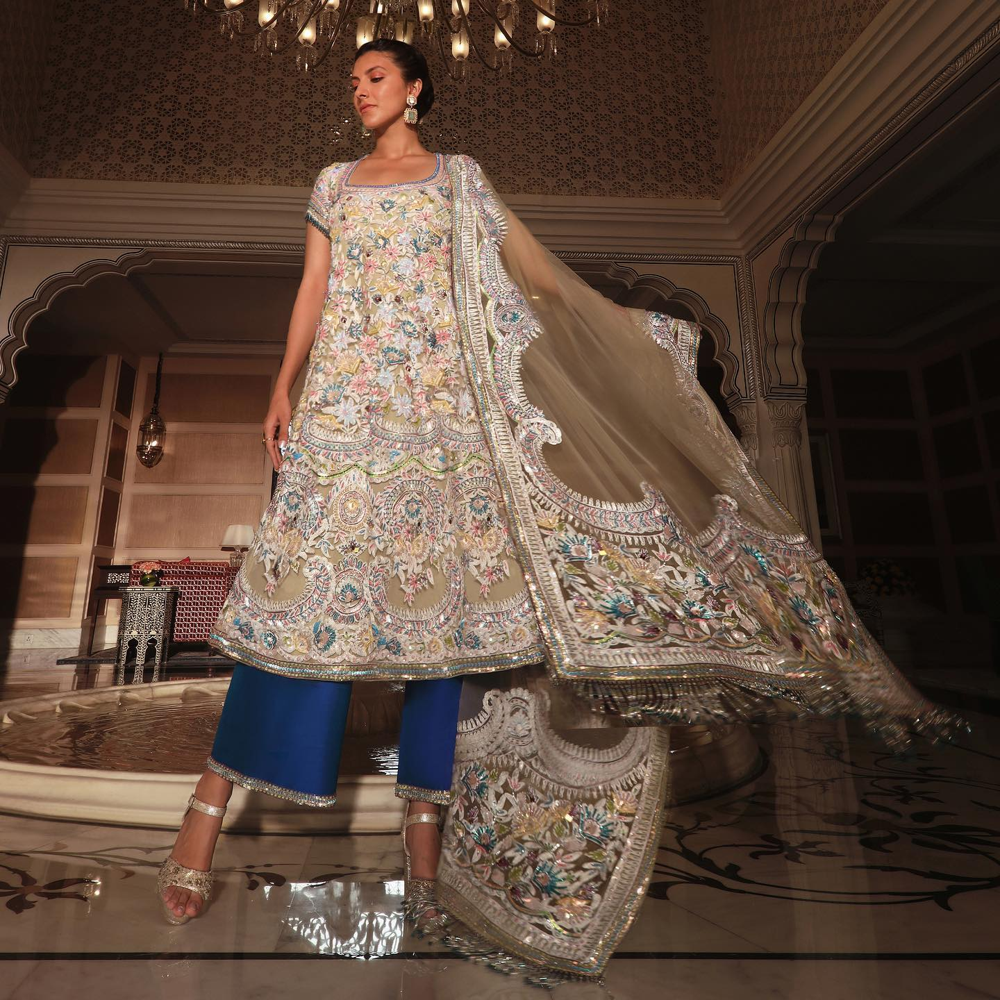 Manish Malhotra eclectic Kashmiri Kalidar embroidered in scalloped floral artwork and bright sequins paired with electric blue palazzos is your sartorial chic summer statement... 2021-04-22