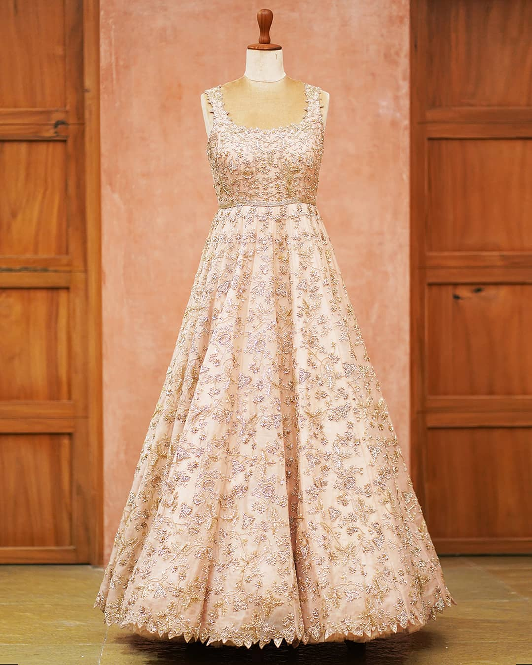 Stunning peach color floor length wedding or reception gown with rich classy hand embroidery work.  2021-04-22