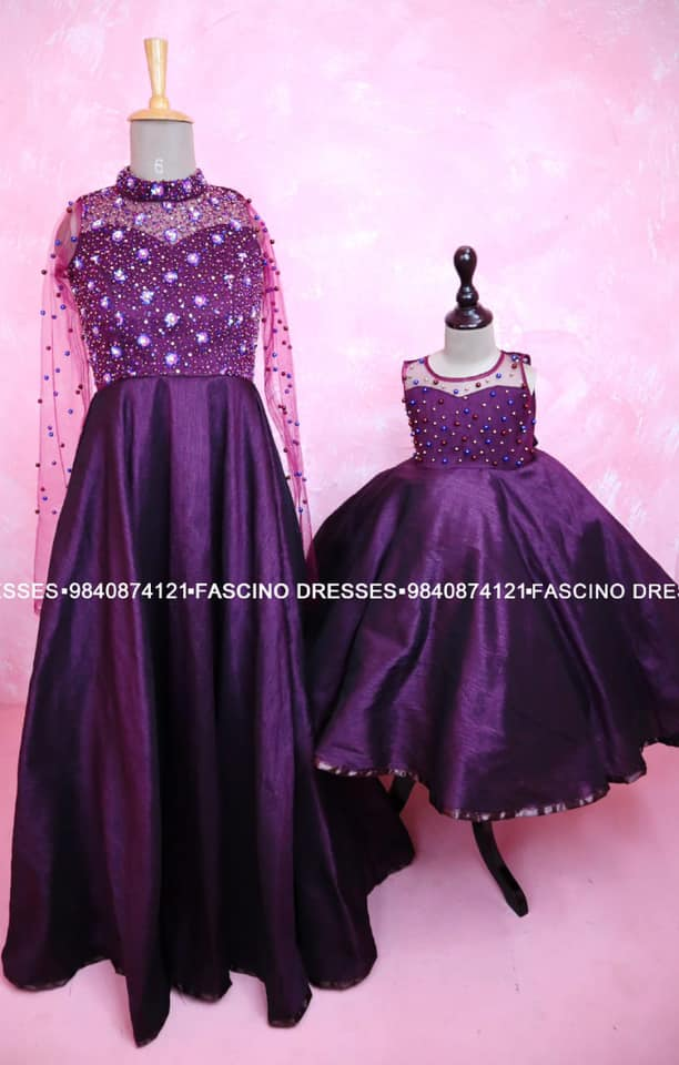 Burgandy Silk handworked mommy gown and pearls embellished baby gown from Fascino . Wats app or inbox to order 9840874121. Can customize in any color / size . 2021-04-23