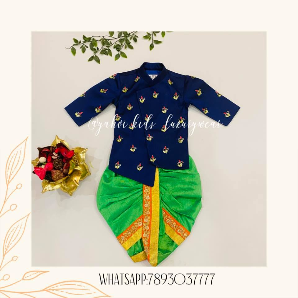 Cross pattern navy blue kids sherwani paired with leaf green dothi.  For Orders : DM or whatsapp on 7893037777. 2021-04-23