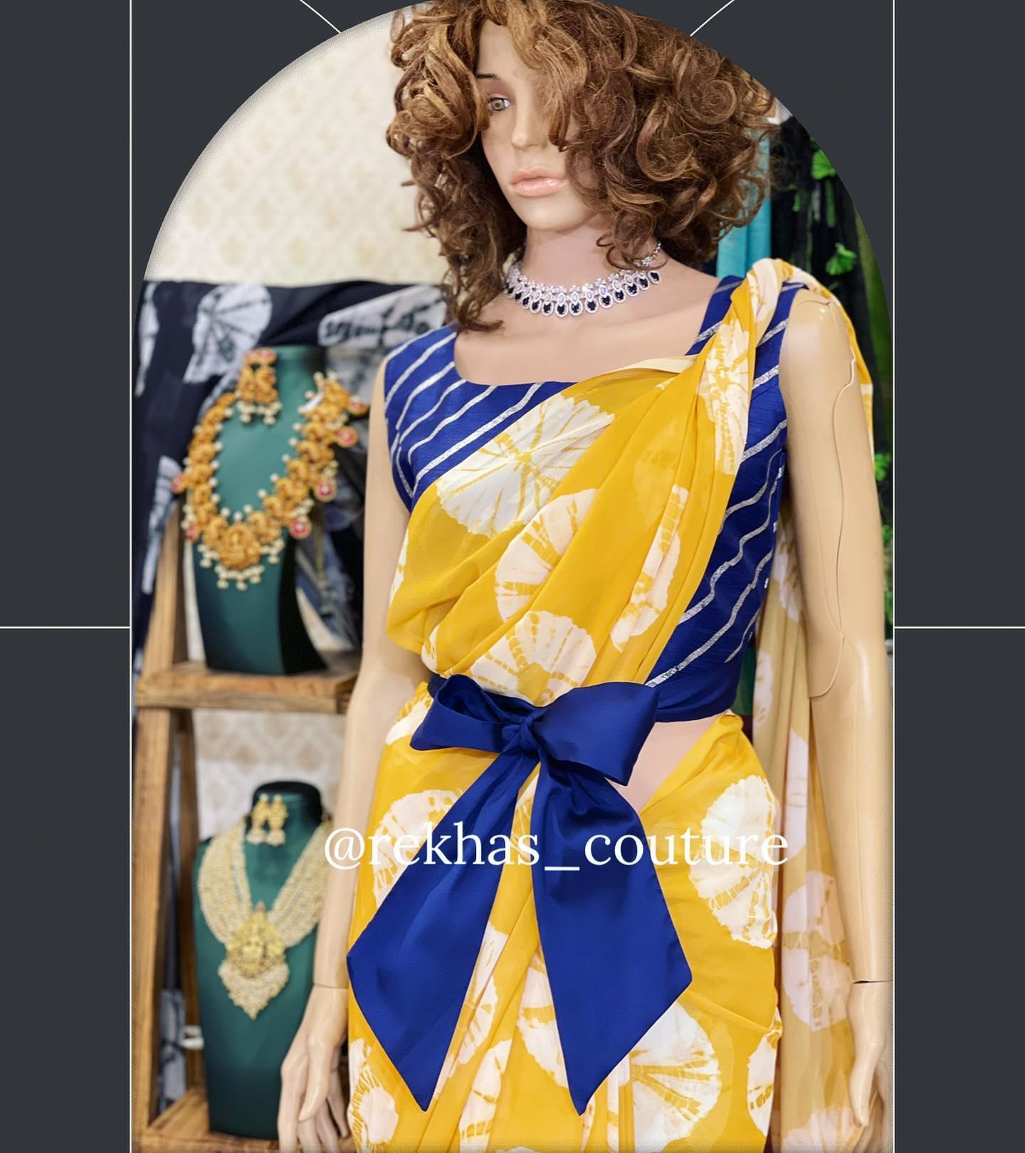 Gorgeous mustard yellow color shibori print saree and blue color blouse. 2021-04-24