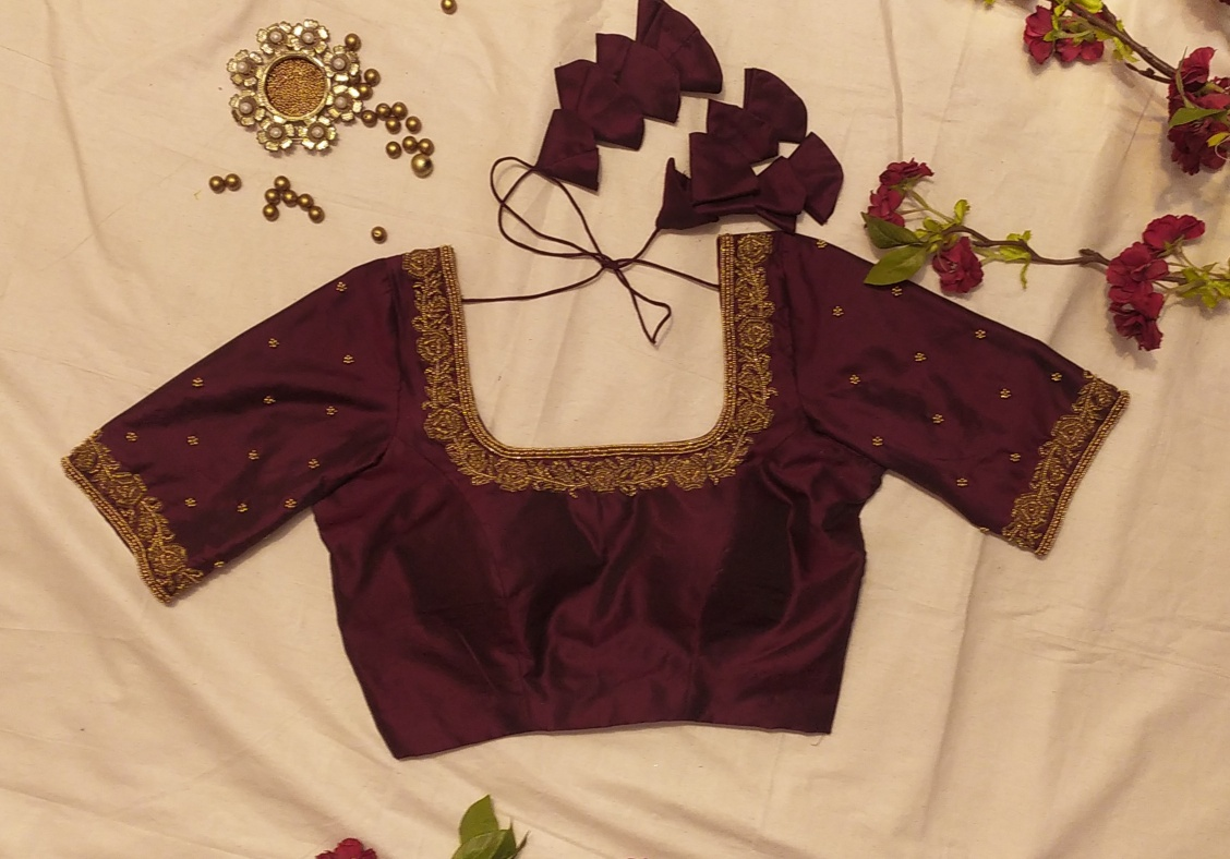 Beautiful deep maroon Embroidered blouse .