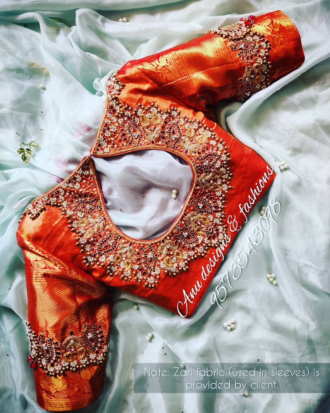 Stunning orange shade brocade blouse with jewel theme hand embroidery work.  2021-04-24
