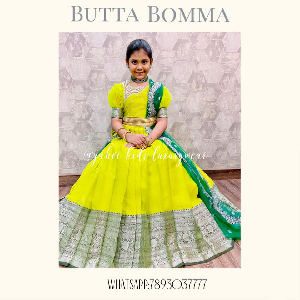 Butta bomma series .... Super excited to bring you this new design in fresh colours .  Beautiful parrot green color kids pattu pavada or kids pattu leheng with net dupatta. They tried to play around neckline to try something different this time .  . For Ordere DM or whatsapp 7893037777 2021-04-26