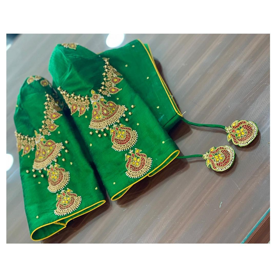 Mix and match your sarees with a jewel work blouse. Stunning green color designer blouse with vanki jewel hand embroidery work.  2021-04-26
