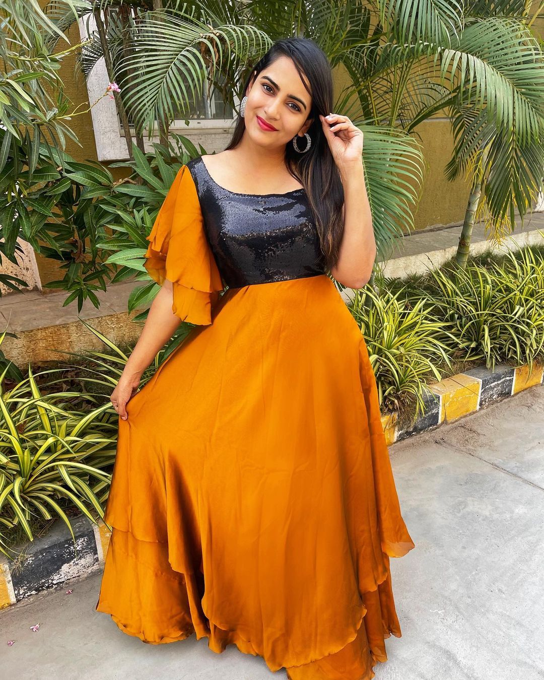Beautiful actress Himaja in Mustard yellow and black color combination floor length dress with ruffle sleeves. 2021-04-27