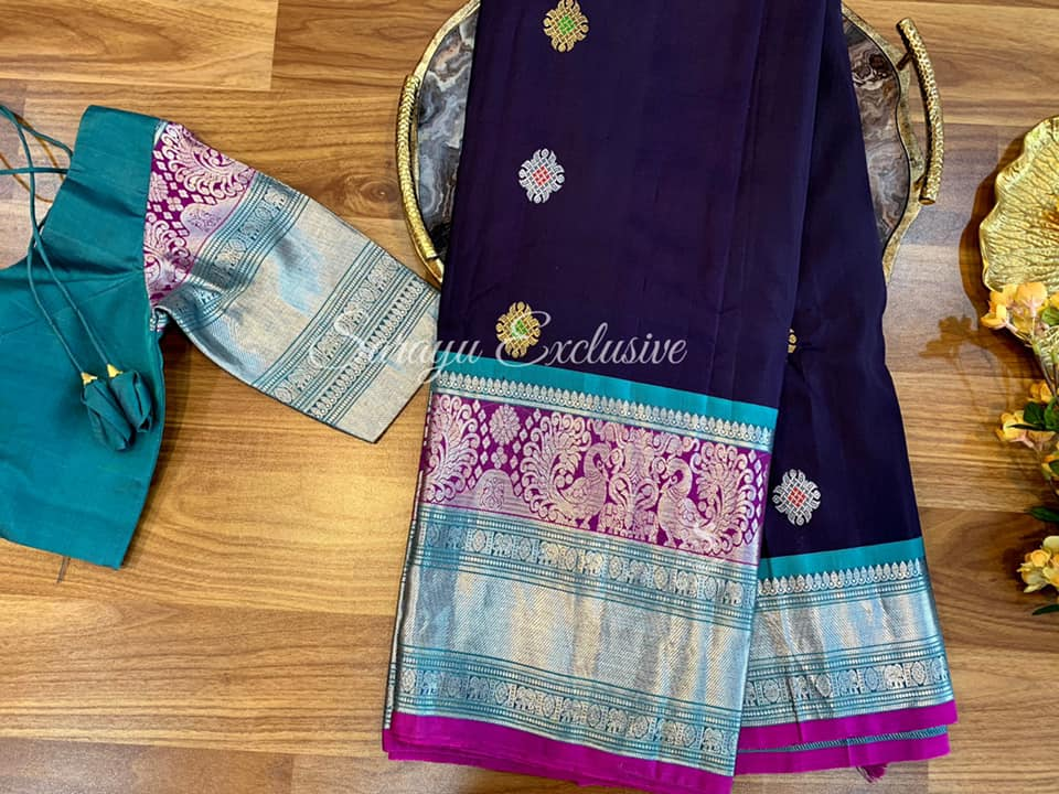 Type: Gadwal Silk  . Description:  Beautiful Deep Nerudu Color with Blue and Magenta Gadwal Silk Saree complemented with contrast saree blouse Patterned blouse Exclusively available @Sarayu . Blouse: Yes Fall and Pico: Yes Inner Skirt: No Price: 375$ Blouse size: 38/40 ✨In Very New combination  In love with this combo  ✨ 2021-04-28