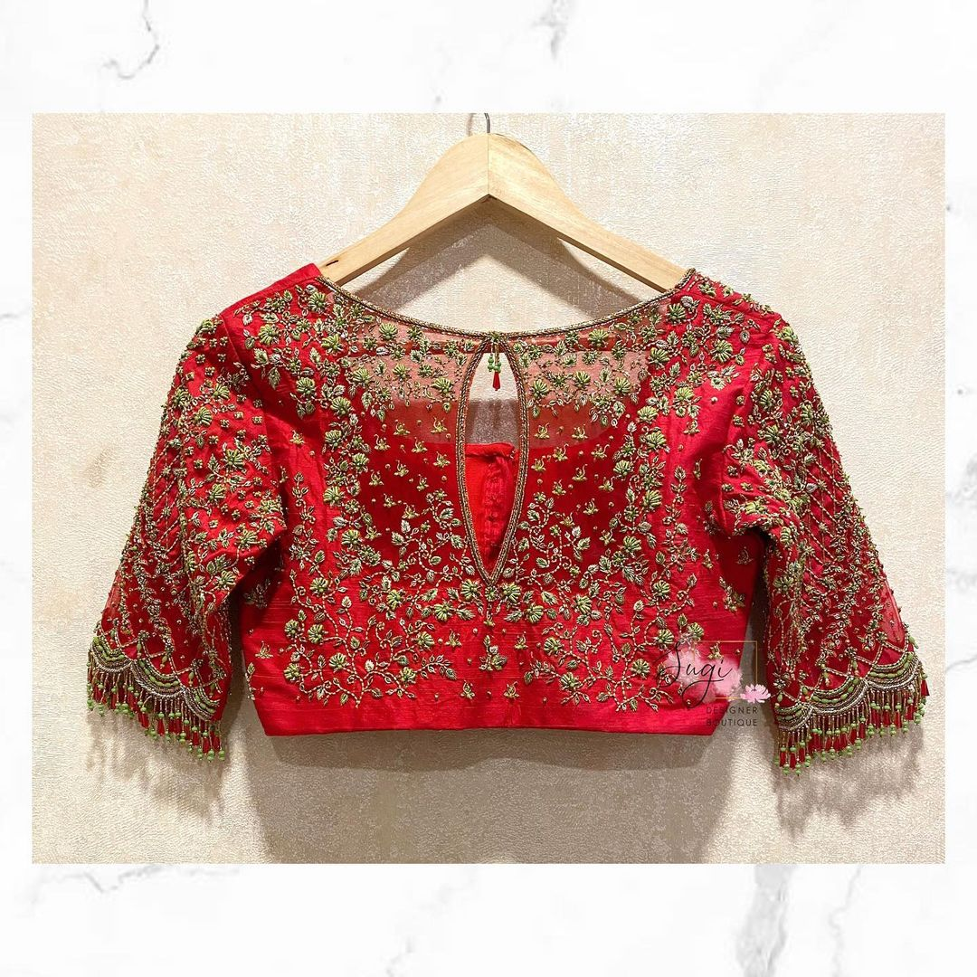 Beautiful red color key hole bridal blouse with tiny floral design hand embroidery bead aari work.  2021-04-28