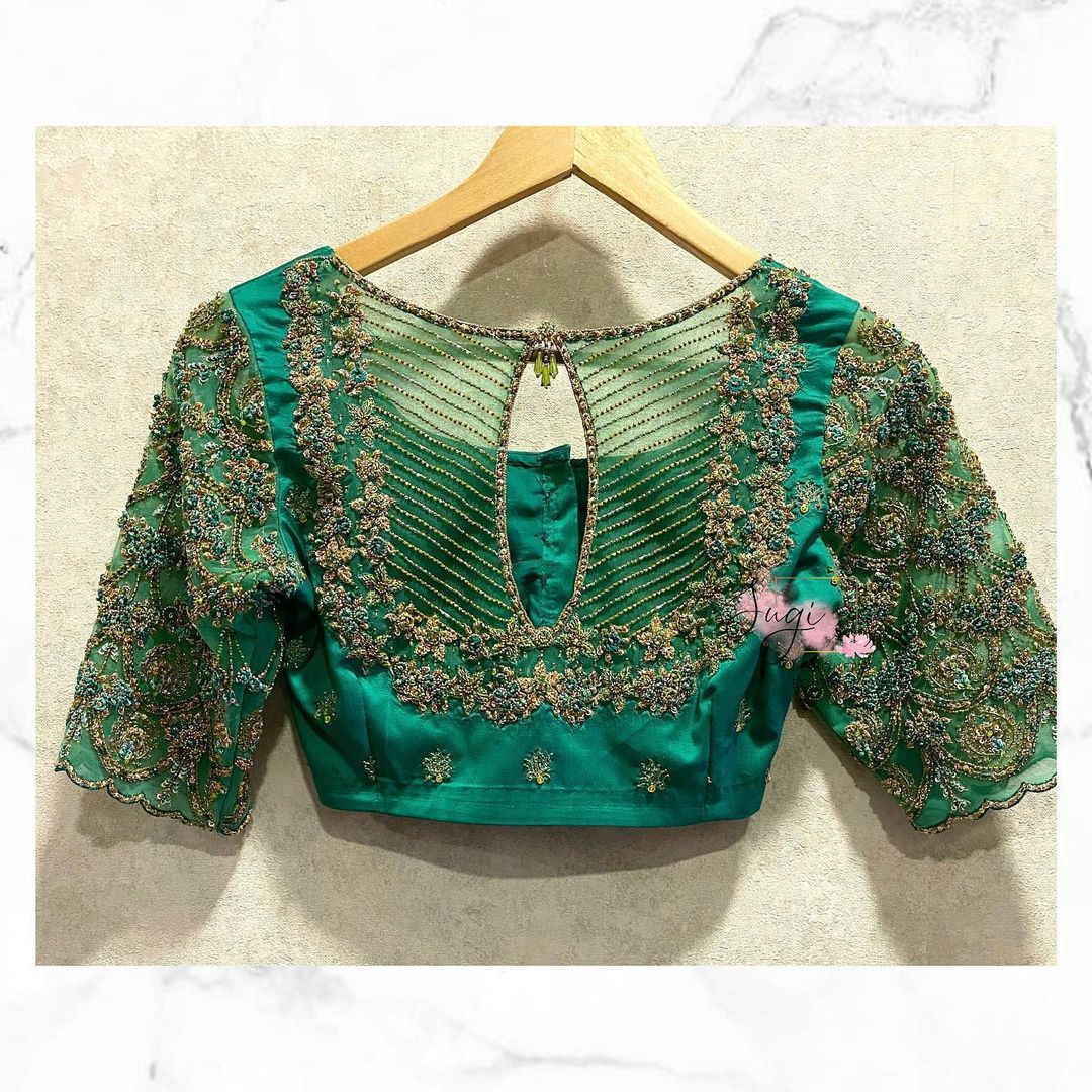 Beautiful sea green color key hole bridal blouse with tiny floral design hand embroidery bead aari work.  2021-04-28