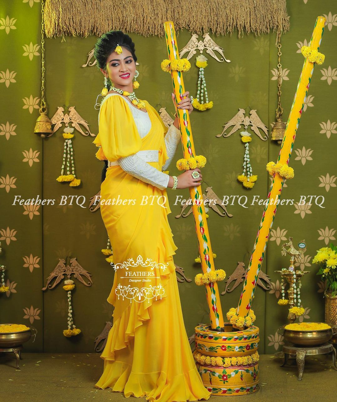 Stunning yellow color ruffle saree and white full sleeves blouse with wasit belt. 2021-04-28