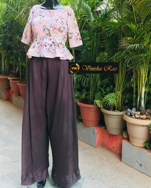 Brown silk palazzo teamed up with glass beads and pearls heavy hand embroidery blush pink blouse. motifs all over the blouse from the house of Vinisha rao designer studio !! Suitable for all kind of occasions !! .. . You can call  to order on