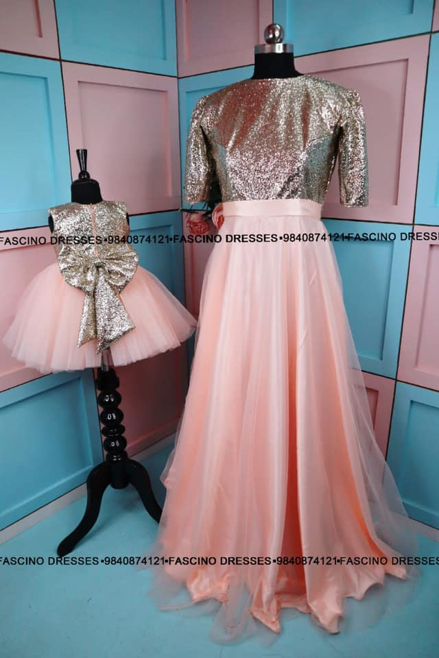 A simple and elegant peach with shimmer golden bodice mom and daughter combo from fascino. Wats app or inbox to order 9840874121 Can customize in any color / size  2021-04-29
