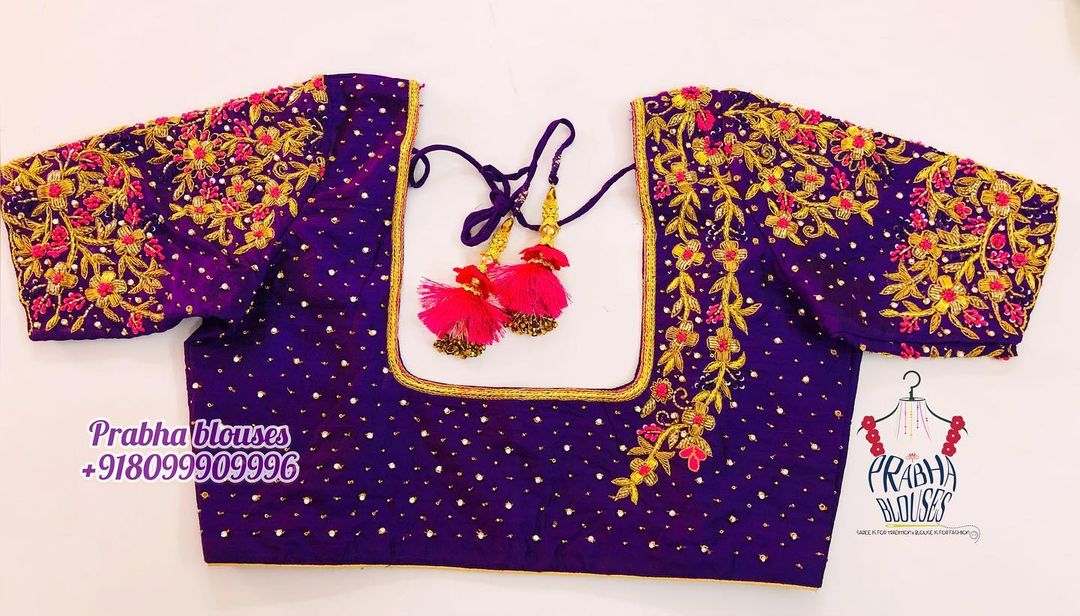 Gorgeous purple color bridal blouse with climber and floral design hand embroidery gold thread maggam work. 2021-04-29