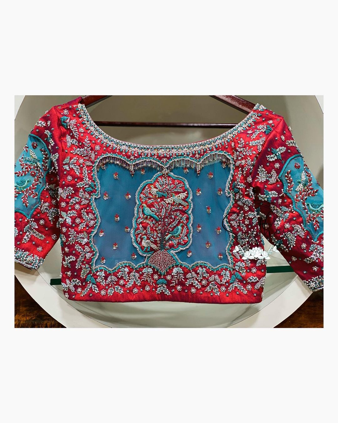 Stunning maroon and sky blue color combination blouse with flying birds and creeper design classy hand embroidery work allover.  2021-04-29