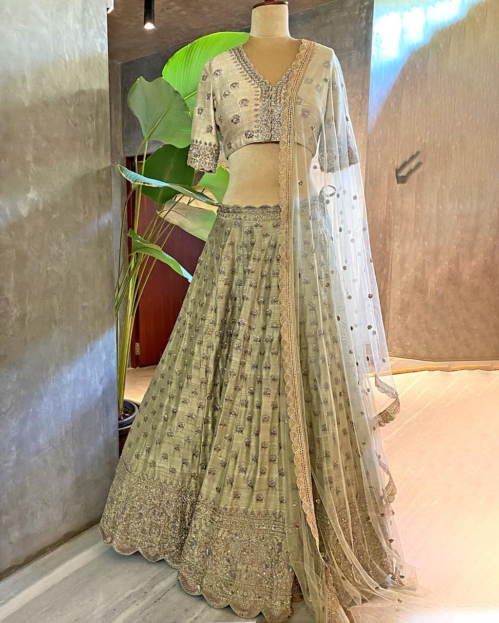Gorgeous olive green color lehenga set with net dupatta. Lehenga with classy hand embroidery work.  2021-04-30